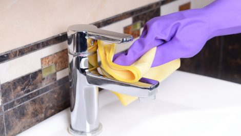 Cleaning bathroom sink close-up; Shutterstock ID 230819341; PO: today.com
